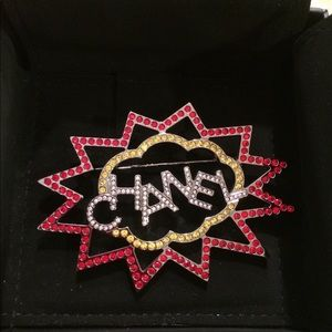 Chanel crystal logo brooch with box and pouch